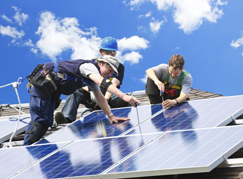 Workers,Installing,Alternative,Energy,Photovoltaic,Solar,Panels,On,Roof