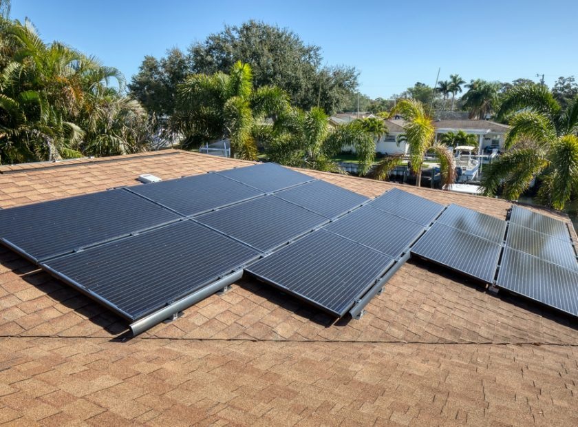 Solar,Panels,On,A,Shingle,Roof,In,Florida,On,A